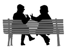 Senior lady friends sitting on bench and talking. Women gossip at the break. Senior lady friends sitting on bench and talking in public park. Grandmothers Royalty Free Stock Image