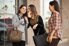 Women gossiping between each other Royalty Free Stock Images