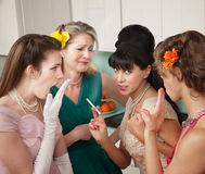Women Gossiping in Kitchen Stock Photography