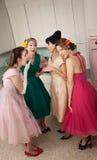 Women Gossips. Group of four retro-styled women gossip in a kitchen Royalty Free Stock Photo