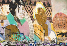Women on Graffiti Wall Stock Photo