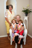Women and Grandchildren. Two women and their grandchildren and great-grandchildren pose for the camera royalty free stock photography