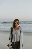 Women in Gray Sweater on Seashore Royalty Free Stock Photos