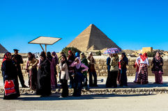 Women at the Great Pyramid of Giza, Cairo, Egypt. This is a picture of women, waiting with an Egyptian police man, close to the Great Pyramid of Giza. December Stock Photography