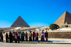 Women at the Great Pyramid of Giza, Cairo, Egypt. This is a picture of women, waiting with an Egyptian police man, close to the Great Pyramid of Giza. December Royalty Free Stock Photos