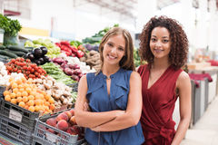 Women at greengrocer Stock Photos