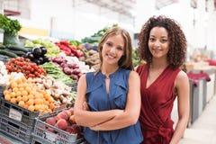 Women at greengrocer Stock Photos