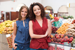 Women at greengrocer Stock Images