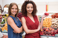 Women at greengrocer Stock Image