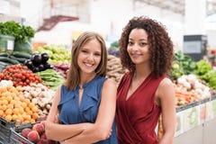 Women at greengrocer Stock Image