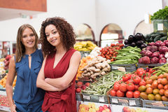 Women at greengrocer Stock Photography