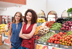 Women at greengrocer Royalty Free Stock Photography