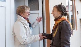 Women greeting girl Stock Photo