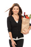 Women with grocery shopping bag Royalty Free Stock Image