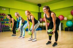 Women group with balls, fitness workout. Female sport teamwork in gym. Fit exercise, aerobic Stock Images