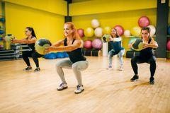Women group with balls in motion, fitness training. Female sport teamwork in gym. Fit exercise, aerobic Stock Photos