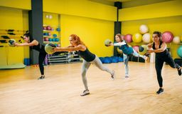 Women group with balls in motion, fitness workout. Female sport teamwork in gym. Fit exercise, aerobic Royalty Free Stock Image