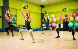 Women group with balls in motion, fitness workout royalty free stock photo