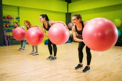 Women group with big balls doing exercise, fitness stock image