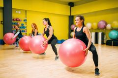 Women group with big balls, fit exercise in motion royalty free stock images