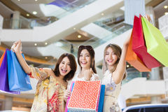 Women group Carrying Shopping Bags in mall Royalty Free Stock Photography