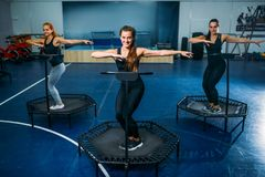 Women group on sport trampoline, fitness training stock images