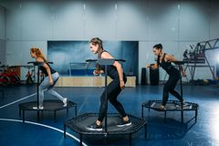 Women group on sport trampoline, fitness workout royalty free stock photos