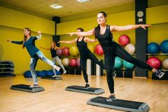 Women group on step aerobic training royalty free stock photo