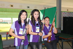 Women with the guns in shooting sport challenge in thailand Stock Photo