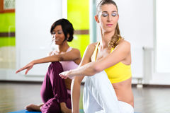 Women in the gym doing yoga exercise for fitness Royalty Free Stock Images