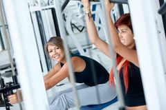 Women at the gym exercising Royalty Free Stock Photos