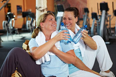 Women in gym taking a break Stock Images