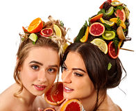 Women hair and facial mask and body care from fruits. Hair and facial mask and body care from exotic fruits for women on spa procedure concept. Fresh fruit on Royalty Free Stock Image