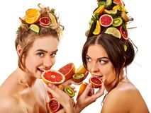 Women hair and facial mask and body care from fruits. Hair and facial mask and body care from exotic fruits for women on spa procedure concept. Fresh fruit on Stock Image