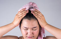 Women with hair loss problems are showing some hair problems on. Gray background stock images