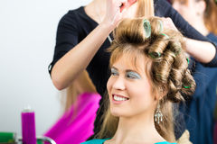 Women at the hairdresser being curled Royalty Free Stock Images