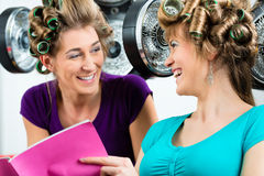 Women at the hairdresser with hair dryer Royalty Free Stock Photos