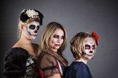Women in Halloween costume Stock Images