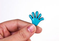 Women hand caching ceramic hand. Women hand caching ceramic small hand Royalty Free Stock Photography