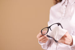 Women hand cleaning glasses lens with isolated background Royalty Free Stock Images