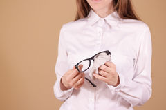 Women hand cleaning glasses lens with isolated background Stock Photography