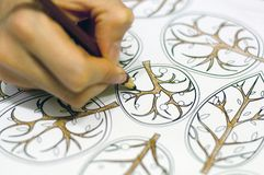 Women hand drawing floral elements Stock Photography