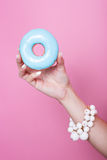 Women hand hold colorful donut Royalty Free Stock Photo