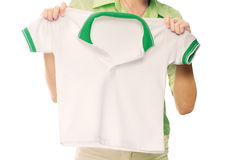 Women hand hold polo shirt Royalty Free Stock Images