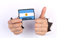 Women Hand Holding Argentina Flag Royalty Free Stock Images