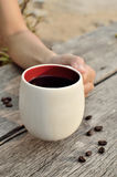 Women  hand holding a coffee cup. Too soft focus Royalty Free Stock Photos
