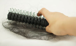 Women hand holding loss hair comb Stock Photography