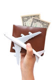 Women hand holding money in wallet and a plane model. Stock Photography