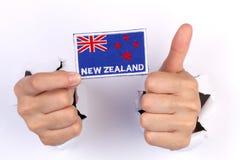 Women Hand Holding Newzealand Flag Stock Image