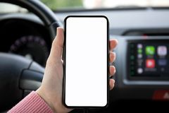 Women hand holding phone with isolated screen in the car Royalty Free Stock Photography